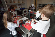 Elementary children cooking in the beautiful children's kitchen at Clanmore.