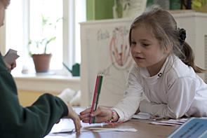 Girl leaning on desk